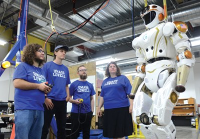 UMass Lowell student and faculty with NASA robot Valkyrie at the NERVE Center