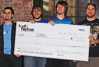 From left, students Jeremy Poulin, Nick Ver Voort, Michael Stowell and Justin Mayhew receive a check for $3,000 for their winning nutrition-training Android app. Photo by Alexandra Foran