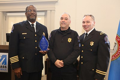 Chief Randy Brashears, Sgt. Mike Soucy and Deputy Chief Ron Dickerson pose with Soucy's Collier Award