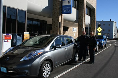 Officers Bill Emmons and Jeff Connors pose with the Nissan LEAF
