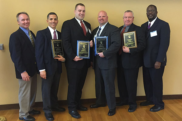 UMass Lowell Police Department members, from left, Deputy Chief Ron Dickerson, Officer Jeff Connors, Officer Ed Davis, Officer Bill Emmons, Ken Wilson and Chief Randy Brashears at the Dec. 18 MACLEA ceremony at Tufts University.