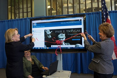 Niki Tsongas and Jacquie Moloney cut the ribbon on Tsongas Collection