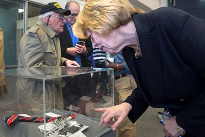Niki Tsongas looks at a collection of Paul Tsongas items