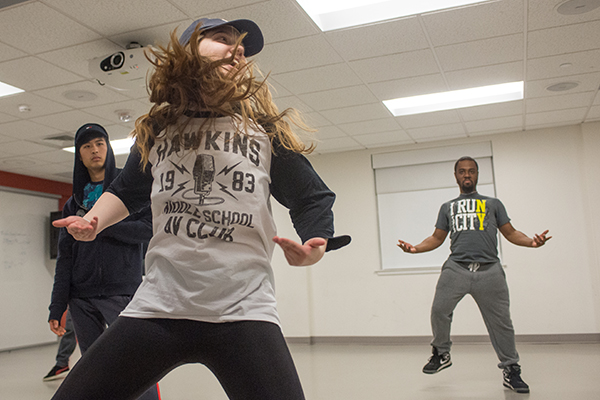 Members of the ProtoHype dance club, one of several dance troupes on campus, practice a routine at Riverview Suites.