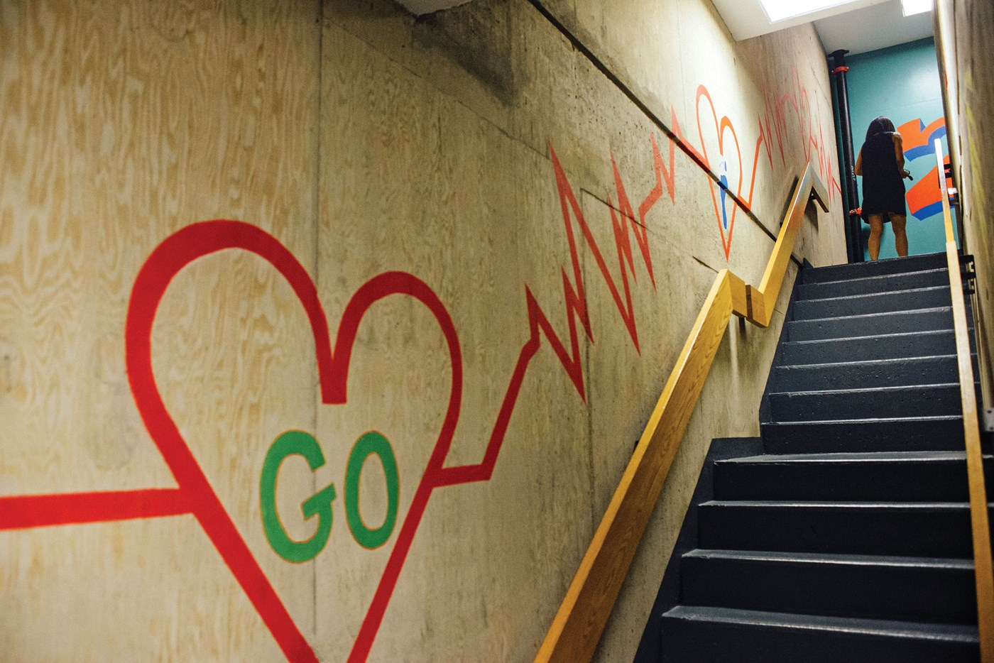 Mural of heart and EKG line in the central stairwell of O'Leary Library