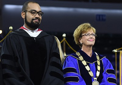 Chancellor Jacquie Moloney, right, with speaker Benjamin O'Keefe at Convocation 2017