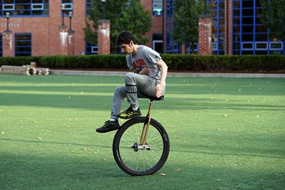 Andrew Terrill demonstrates his unicycle riding skills