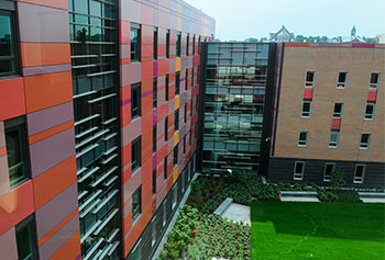 The growth of both UMass Lowell and the system's positive economic impact was driven over the last three fiscal years by construction projects, such as UMass Lowell's University Suites, shown here.