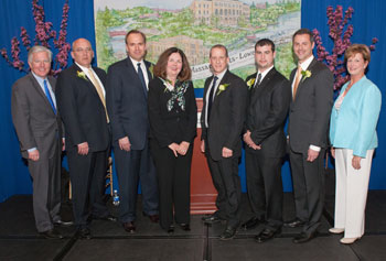 On the left, UMass Lowell Chancellor Marty Meehan and on the far right, Executive Vice Chancellor Jacqueline Moloney with 2012 University Alumni Award honorees James Regan, Robert LeFort, Linda FitzPatrick, Richard Miner, Michael Jarvis and Steven DiNoto.