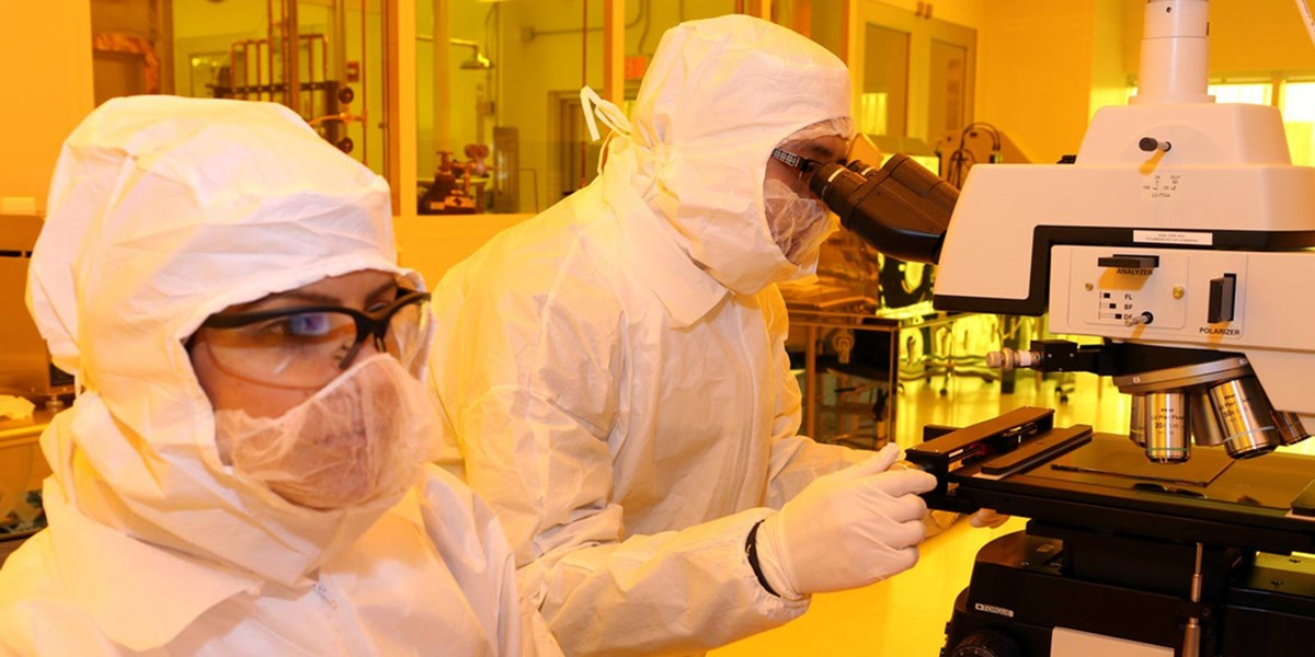 Two people working in the clean room at the Saab ETIC Building.