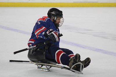 Student-veteran Ian Ramsdell demonstrates sled hockey at the Tsongas Center.