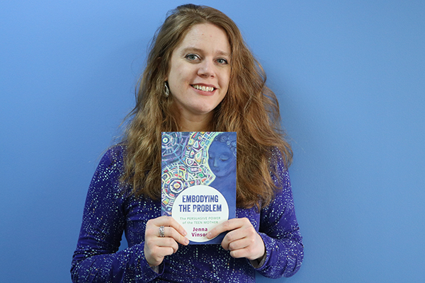 "Jenna Vinson, an assistant professor of English, with her book on the shaming of young mothers, ""Embodying the Problem."""