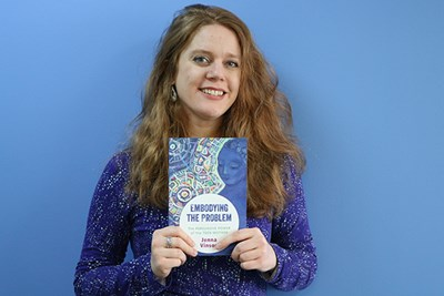 UMass Lowell Asst. Prof. of English Jenna Vinson with her new book,