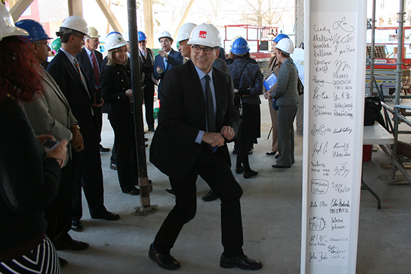 Members of the Manning School of Business Advisory Board tour the Pulichino Tong Business Center construction site, where virtual signatures have been added to a ceremonial beam.