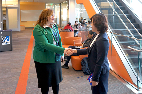 Manning School Dean Sandra Richtermeyer greets Fulbright Visiting Scholar Tu Tran at the Pulichino Tong Business Center.