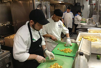 Campus dining staff prepares Garcia Brogan's chipotle potatoes au gratin as part of the Visiting Chefs program.