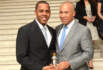Vladimir Saldana accepts the '29 Who Shine' award from Gov. Deval Patrick at the Massachusetts State House on May 2. Photo by KulbakoPhoto