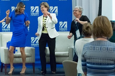 Designer Taniya Nayak, Chancellor Jacquie Moloney and Dean of Education Anita Greenberg dance at the conference opening