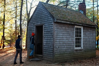 Honors College students visit a replica of Thoreau's cabin near Walden Pond.
