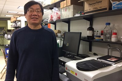 Chemistry Prof. Yuyu Sun in his laboratory