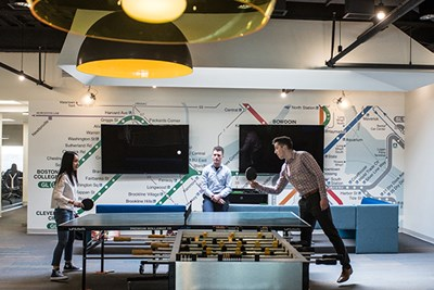 Mai Pham, Brian Regan and Joshua Bedard enjoy ping-pong at Wayfair
