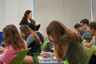 Asst. Prof. of Psychology Yana Weinstein gives students questions to write about and discuss in class.