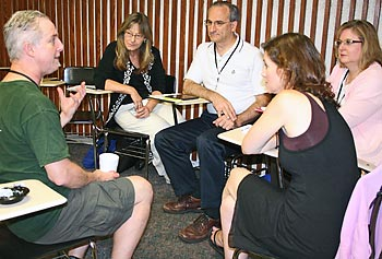 Teachers engage in lively group discussions during this year's CS4HS workshop and conference.