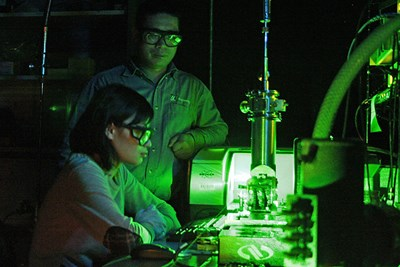 Prof. Xuejun Lu and his student working in the lab