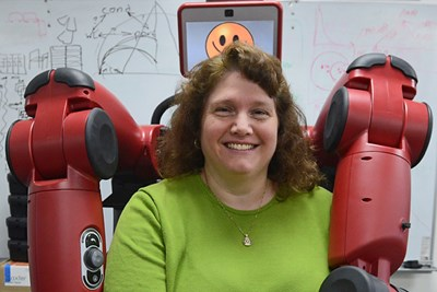 Prof. Holly Yanco with a Baxter robot