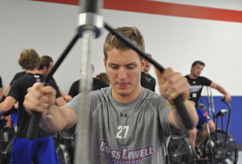 Sophomore defenseman Zack Kamrass trains with his teammates in the new hockey performance center. Photo by Bob Ellis.