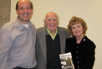 "Prof. Jonathan Silverman, left, and Prof. Jeannie Judge celebrated the release of Prof. Joseph Zaitchik's first novel, ""The Fitting,"" with their colleague, center."