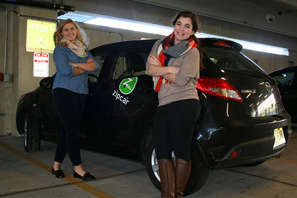 Student Government Association members Meaghan Gallagher, left, and Rachel Seeley are happy to see more Zipcars available for students to rent.