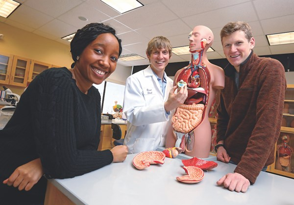 Asst. Teaching Professor Brent Shell (center) with students in the renovated anatomy and physiology lab