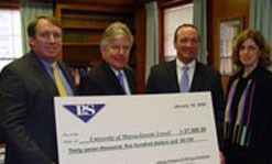 Marty Meehan stands with check presented by Powers and Sullivan accounting firm