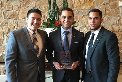 ALPFA members Edwin Naranjo, Christopher Nunez and Michael Ortiz share the UMass Lowell chapter's award in Dallas.