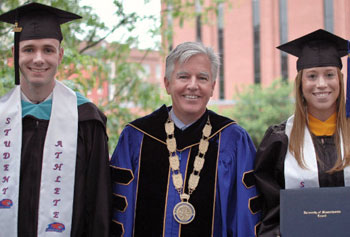 Senior Angus MacDonald, Chancellor Marty Meehan and Senior Ashley Zielinski