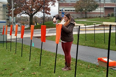 Ashley Brown installing her art project on South Campus