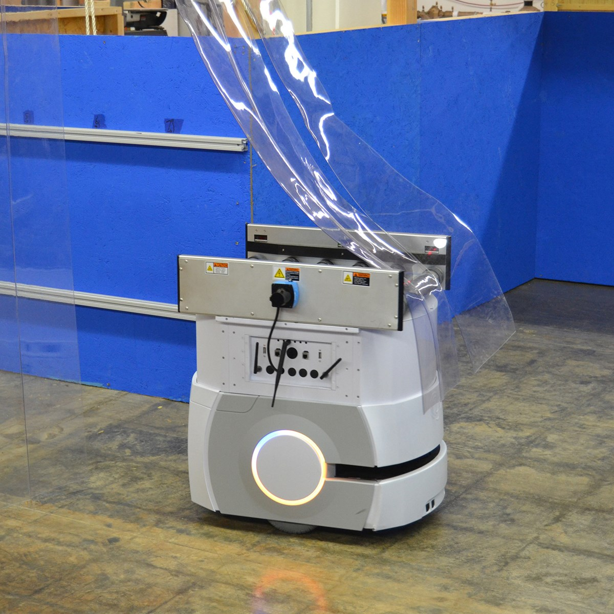 Omron Adept Lynx robot navigates through a test apparatus for soft partitions.