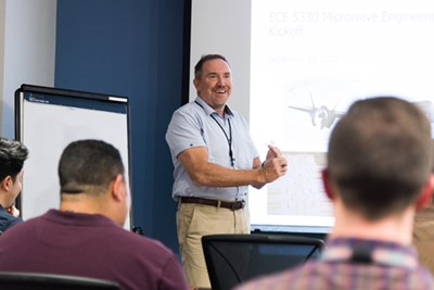 BAE executive Ray Brousseau '86 speaks to students in the UML graduate certificate course in microwave engineering, taught on the BAE Systems campus.
