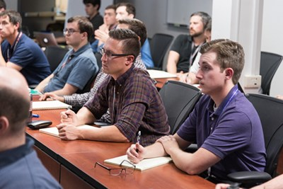 UMass Lowell graduate certificate students take a course in microwave engineering on the BAE Systems campus.