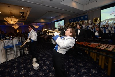 The current UMass Lowell Marching Band serenades their predecessors during the band's 40th reunion and the UML Inn & Conference Center.