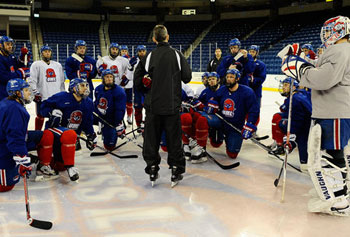 Norm Bazin, at center, has led UMass Lowell to an N.C.A.A. tournament berth in his first year as the team's coach.