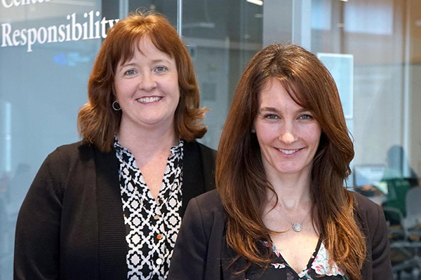 Elissa Magnant, left, and Erica Steckler are UMass Lowell Manning School of Business faculty members and co-direct the Richard and Nancy Donahue Center for Business Ethics and Social Responsibility.