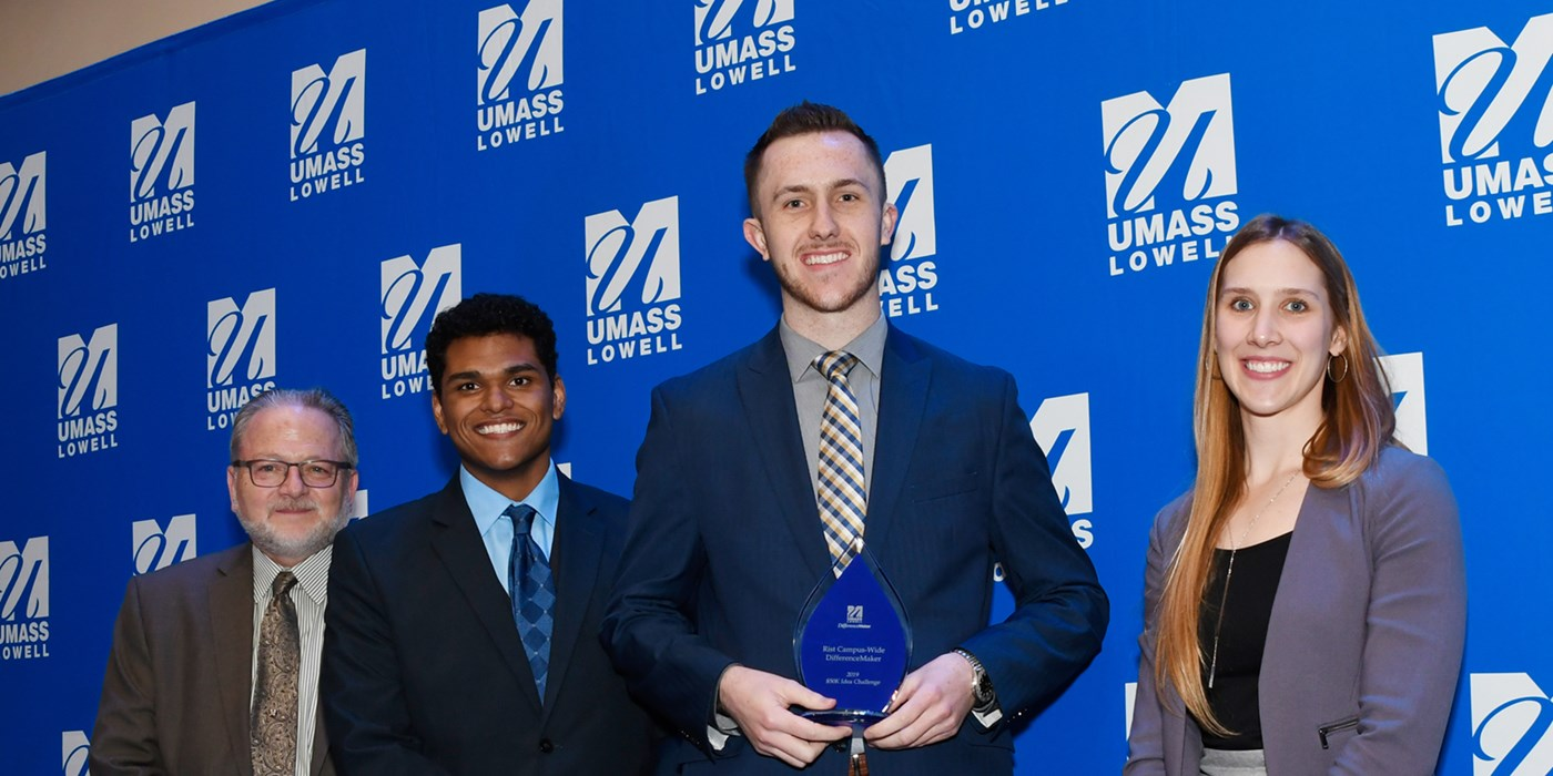 From left to right: Steve Tello, Edward Morante, Benjamin Mcevoy (holding the Rist Campus Wide DifferenceMaker award) and Holly Butler