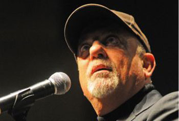 Billy Joel on stage at UMass Lowell's Durgin Hall last night.