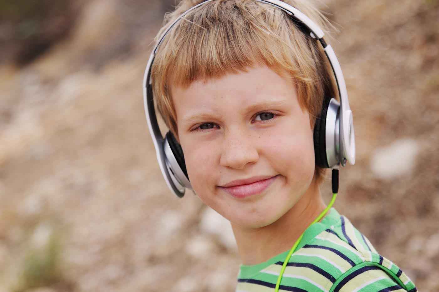 young boy wearing headphones