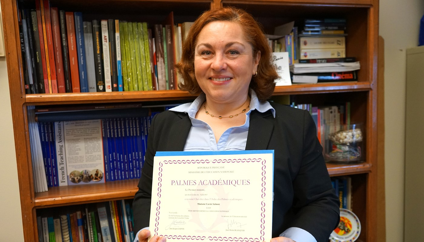 UMass Lowell French professor Carole Salmon, pictured with a prestigious award she won from the French government