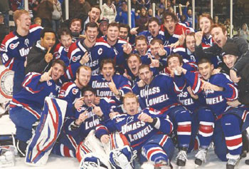 UMass Lowell players celebrate the program's first-ever Hockey East regular-season title Saturday night in Providence, R.I., after the River Hawks topped Providence, 4-1 at Schneider Arena. River Hawk fans rejoice in their seats.