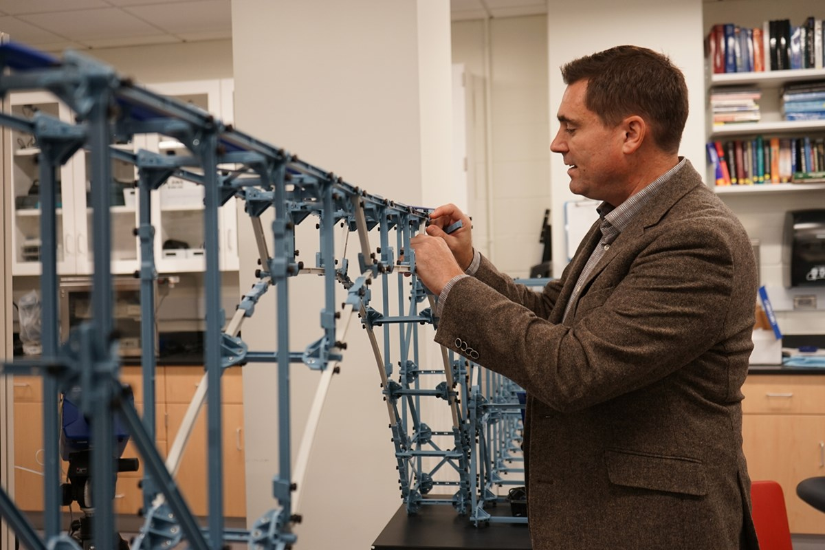 Christopher Ingemi works on a model of a bridge
