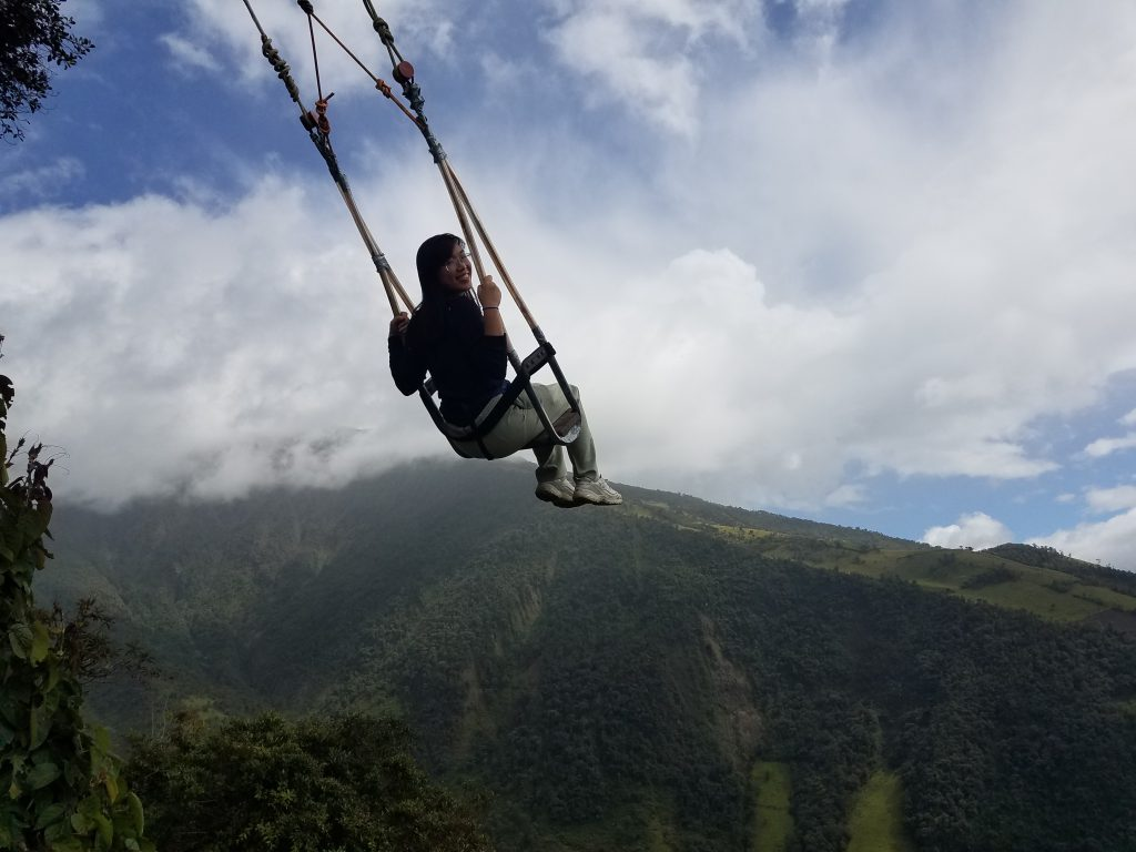 UMass Lowell study abroad on a forest cloud swing at Casa Del Arbol in Ecuador.